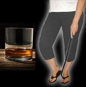 glass of bourbon and woman holding a switch