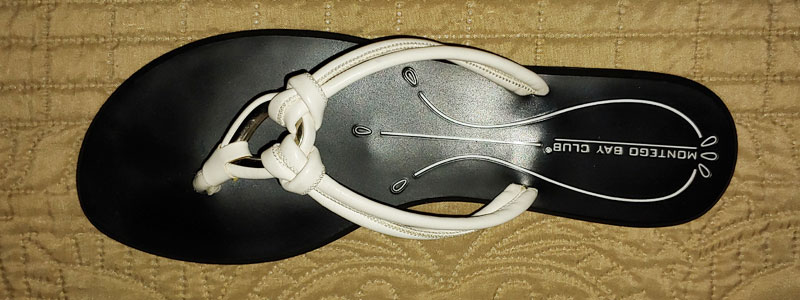 black plastic spanking sandal