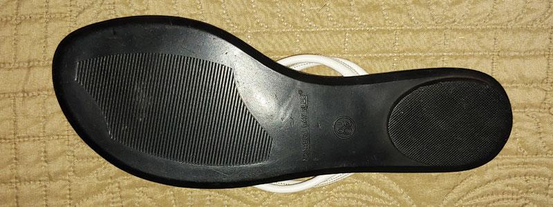 black plastic spanking sandal bottom