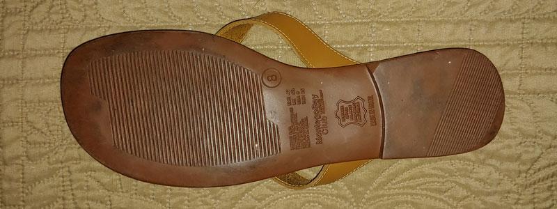 tan spanking sandal bottom